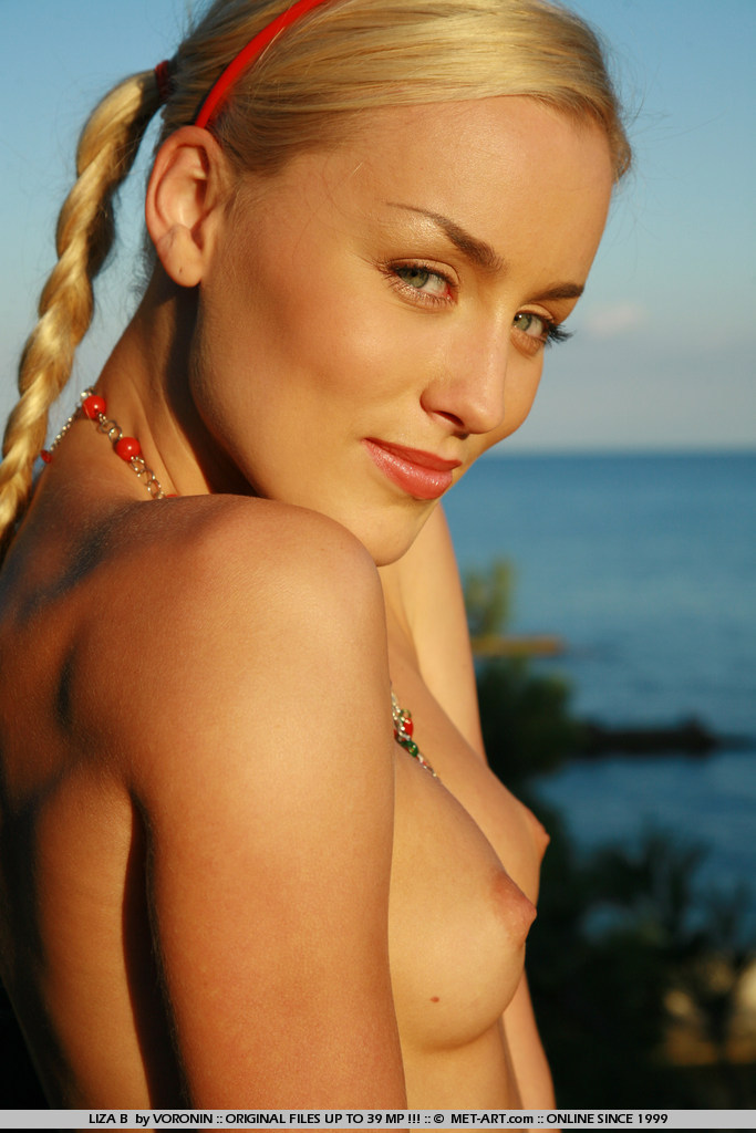 Silky blonde with pigtails and a toned body on vacation.