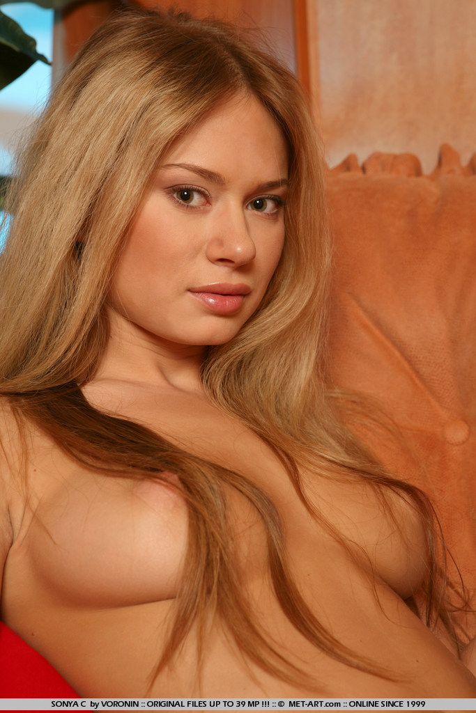 Dirty blonde with big long hair has big excited nipples and the look of pleasure.