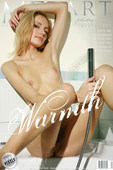 Sensual blonde with slim beautiful body enjoys a light shower.
