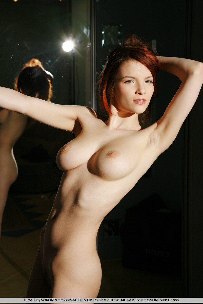 Hot redhead with large breasts goes Goth.