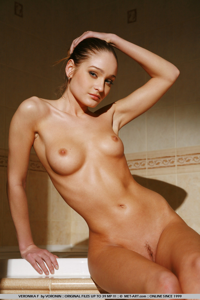 Young girl with stunning body and small firm round breasts gets clean in a public bath house.