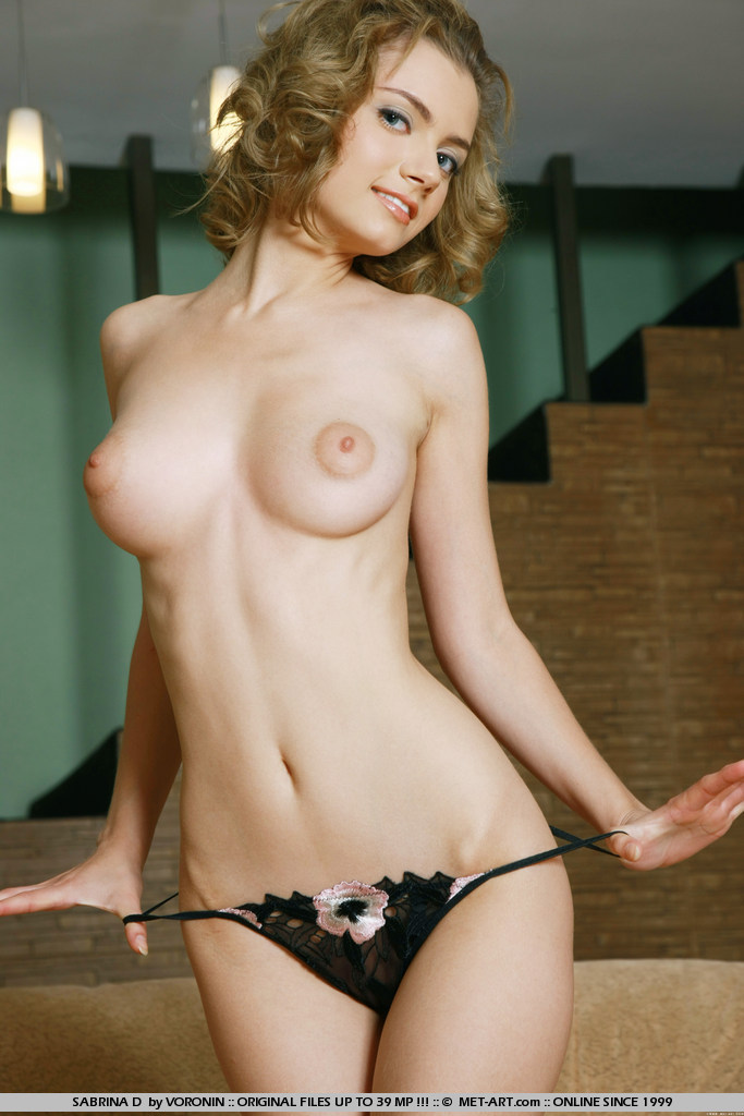 Sweet Sabrina has big eyes that glow and large breasts that flow and nothing on but a smile.