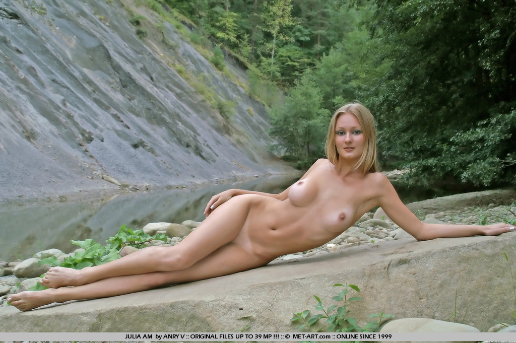 Blonde Julia has bigger boobs with white bikini triangle lines she is outdoors and playing in the river.