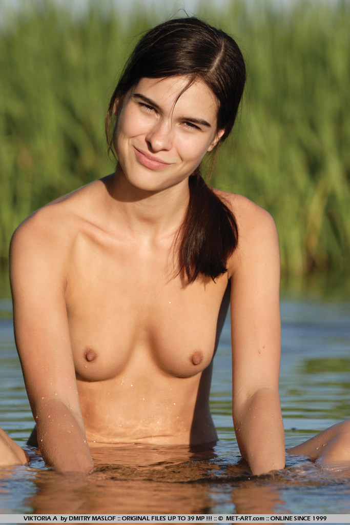 Freaky Viktoria gets natural in the wetlands, revealing her petite breasts and clean bush.