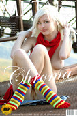 LILU, Funky sox and big lips do not deter from this blondes beauty.