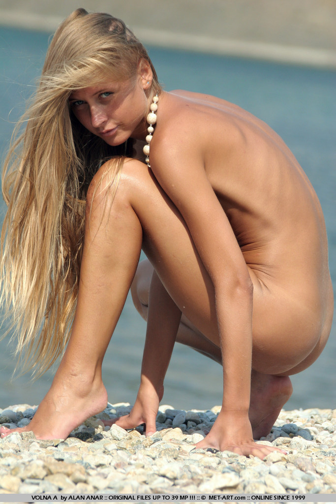 Surfer girl Volna exposes her lean and tanned body out at the beach.