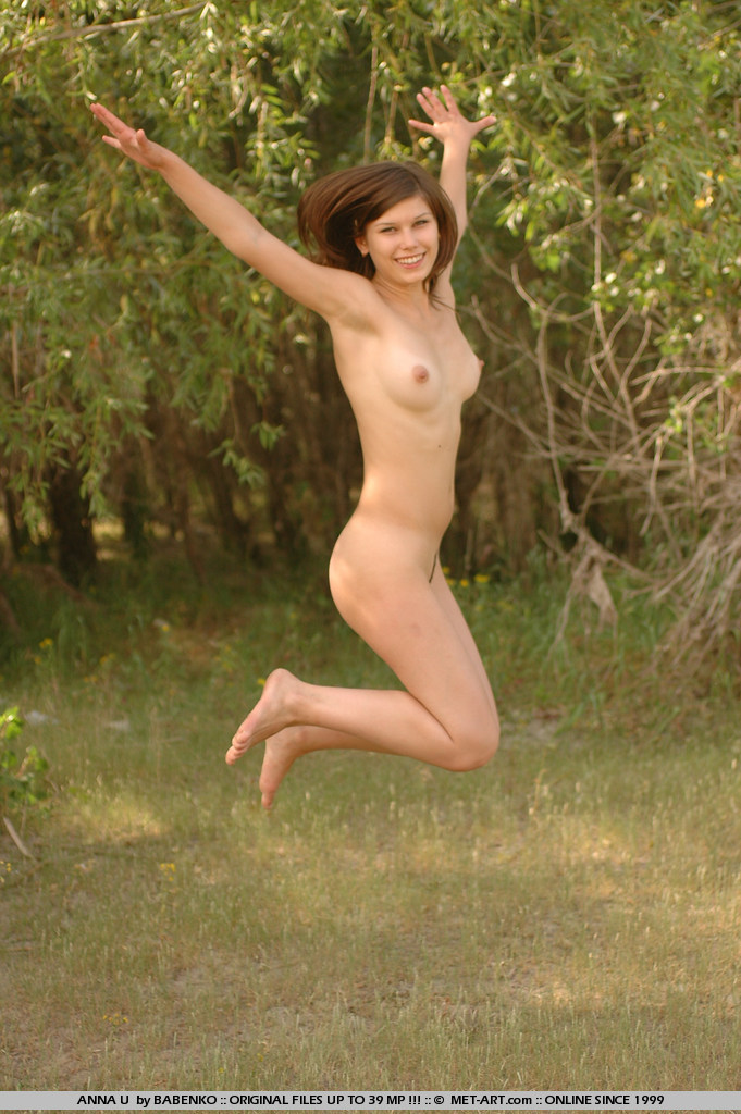 Athletic brunette gets completely naked outdoors and just has fun.