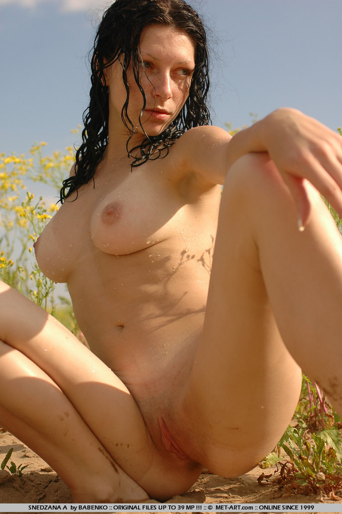 Amateur model goes out to the park and plays in the ponds and mud.