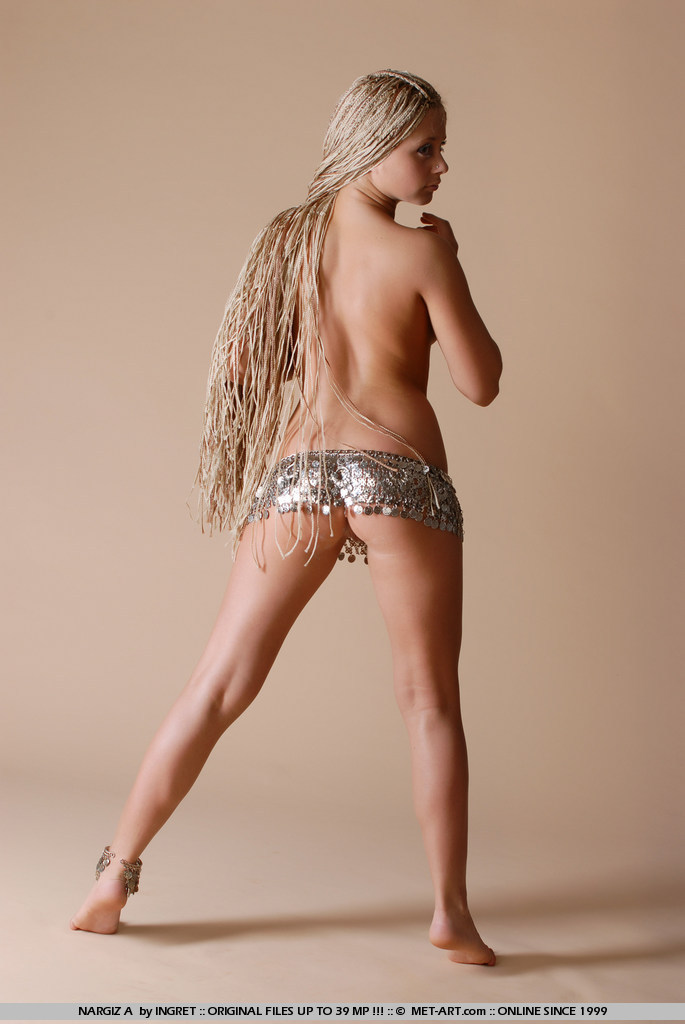 Native Nargiz reveals her firm breasts and round ass while playing with her long blonde braids.