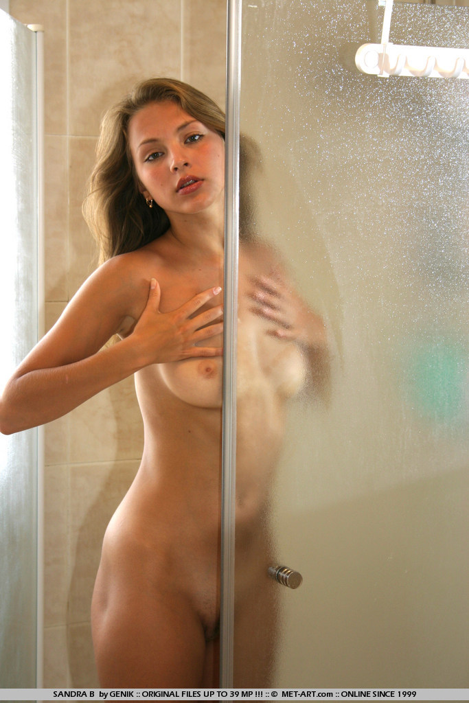 sandra naked bathes in a shower