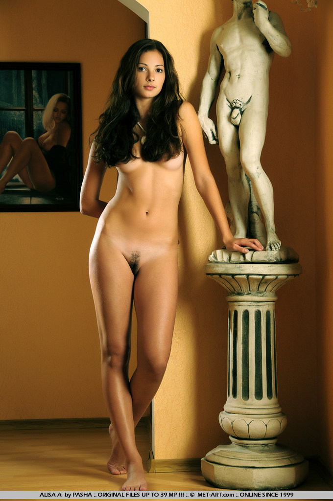 Tanned girl with long dark hair has a face you will love and a body you will lust for.