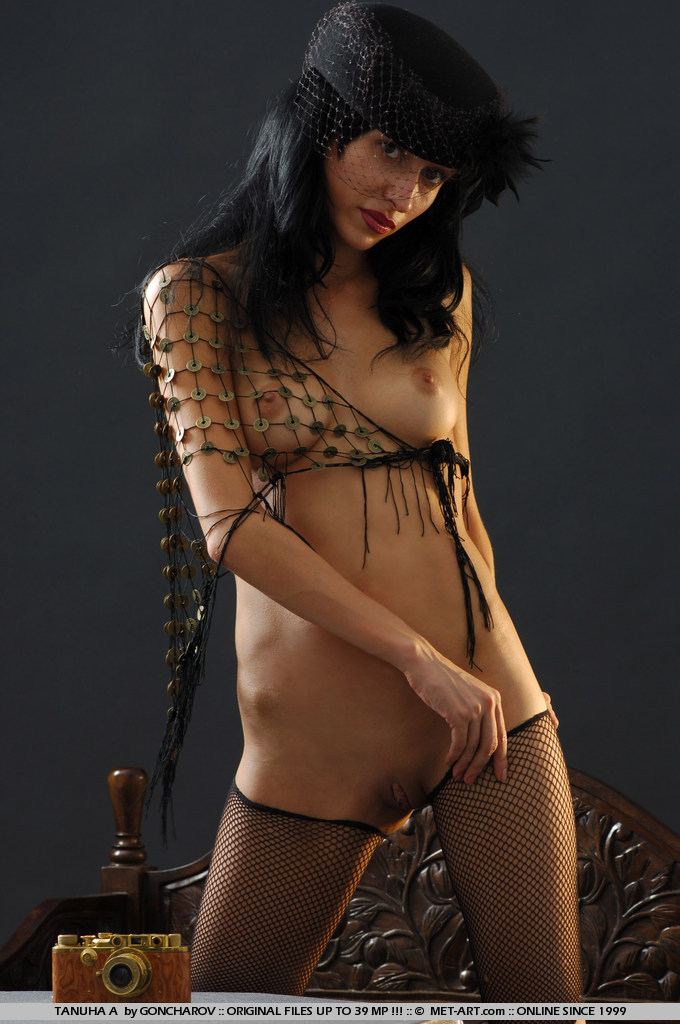 Dark haired and flexible model has two sets in one on this one.