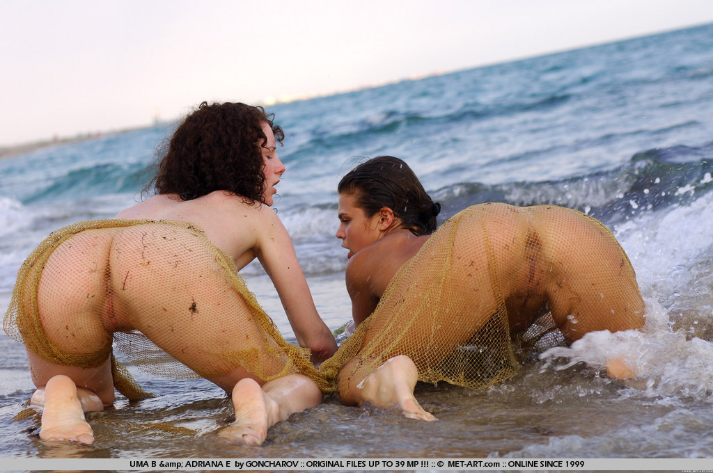 Two mermaids with dark hair caught in a net of love and they take advantage of all the action.