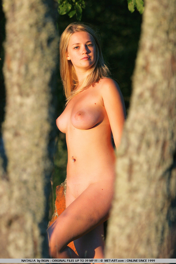 Full figured Natali prances in the woods and shows her wonderful women features to all.