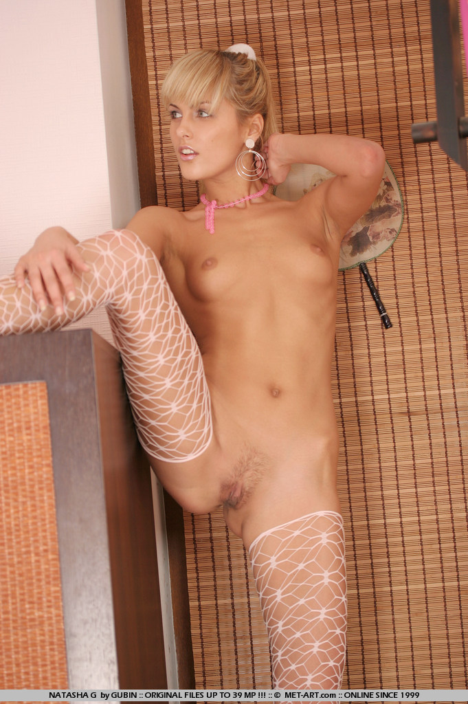 Natasha in pink and white lace shows her figure with aggressive style.