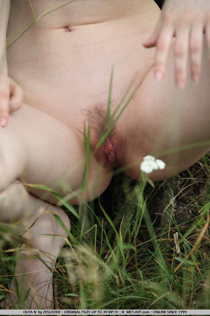 New model Olya displays her labia and milky skin in this outdoor shoot.