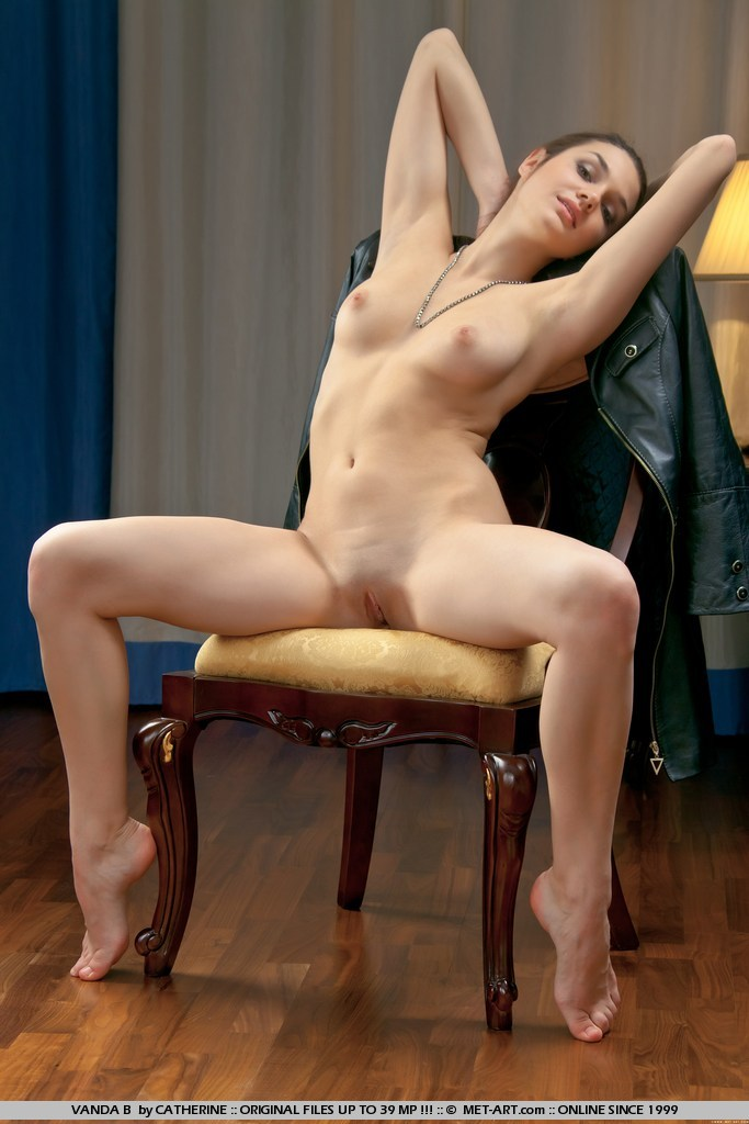 legs spread on a chair naked